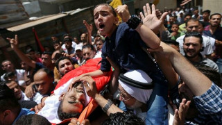 Palestinians mourn paramedic shot during clashes along Gaza border