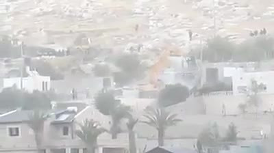 Israeli army demolishing Palestinian house in al-Quds